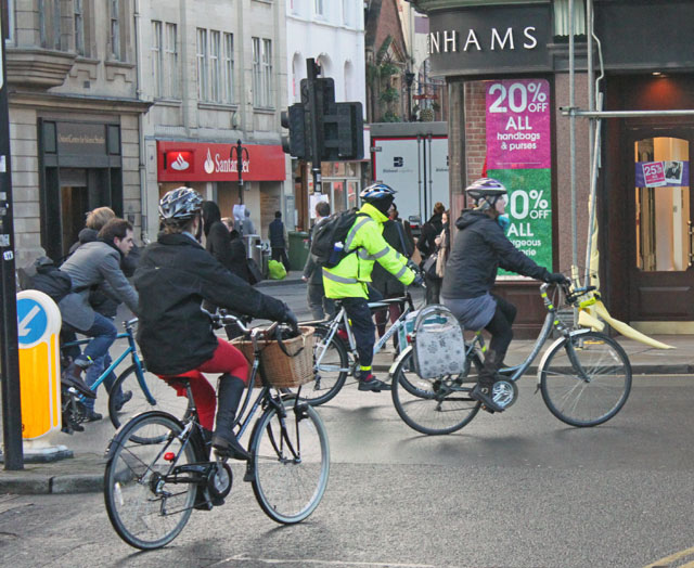 Cycle commuters in front of Debenhams